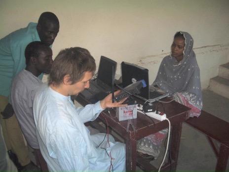 A volunteer teaches a networking class